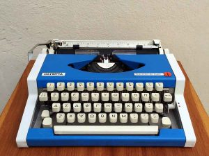 Vintage Typewriter Olympia Traveller De Luxe On Greek Characters.
