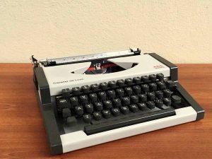 Vintage Typewriter AEG Olympia Traveller De Luxe On Greek Characters.